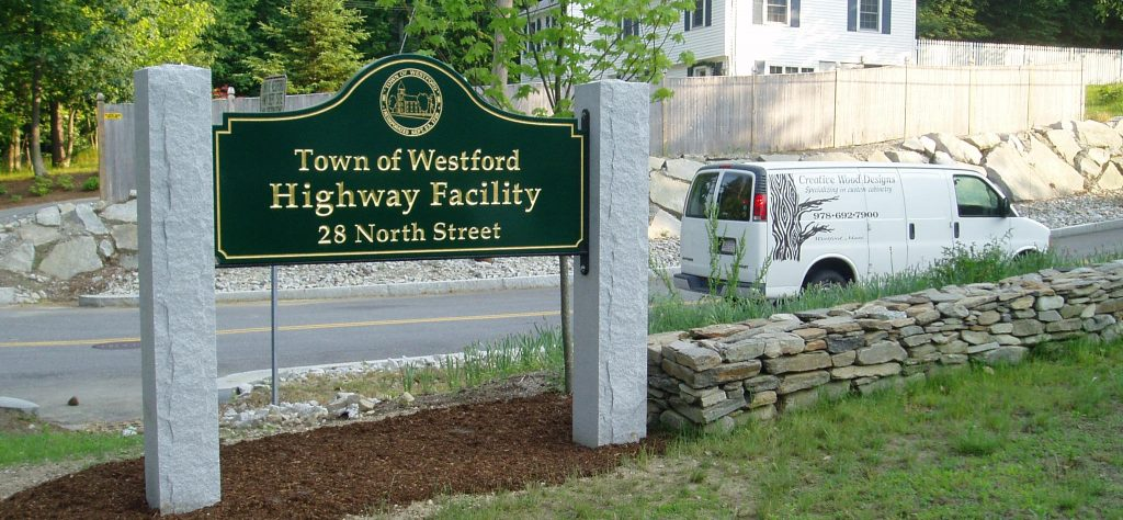 Town sign installed on granite pillars